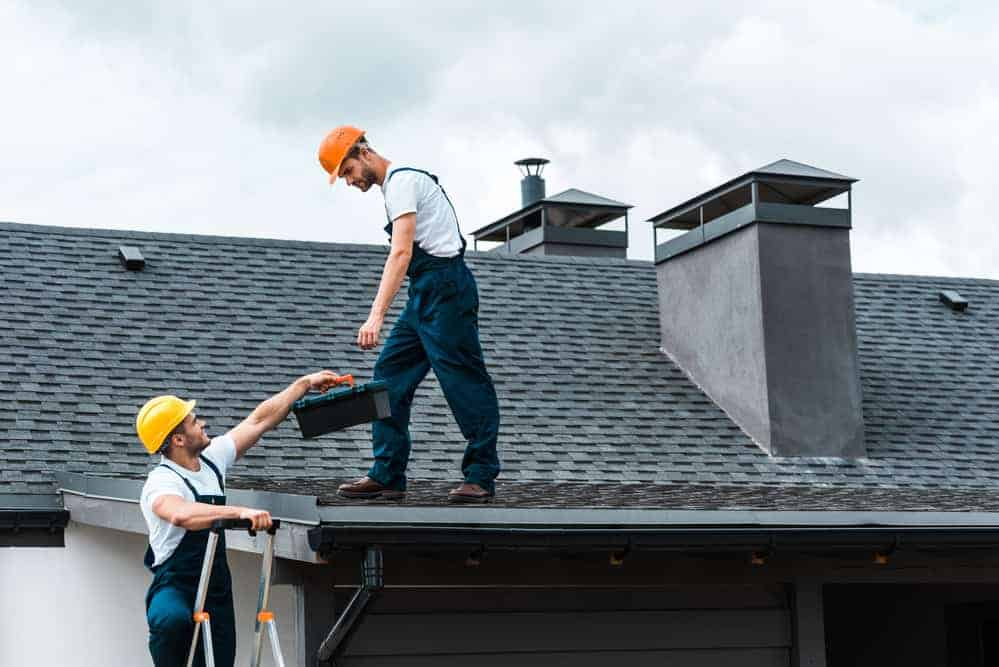 workers fixing roof